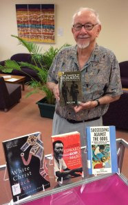 JCU Associate Professor Noel Loos with some of his publications from the NQ Collection, JCU Library Special Collections.